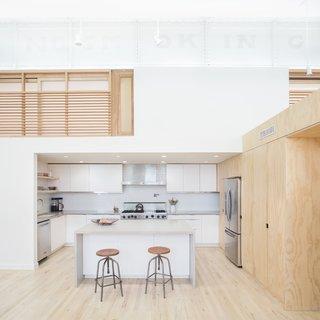 Kitchen with loft bedroom sliding screens above