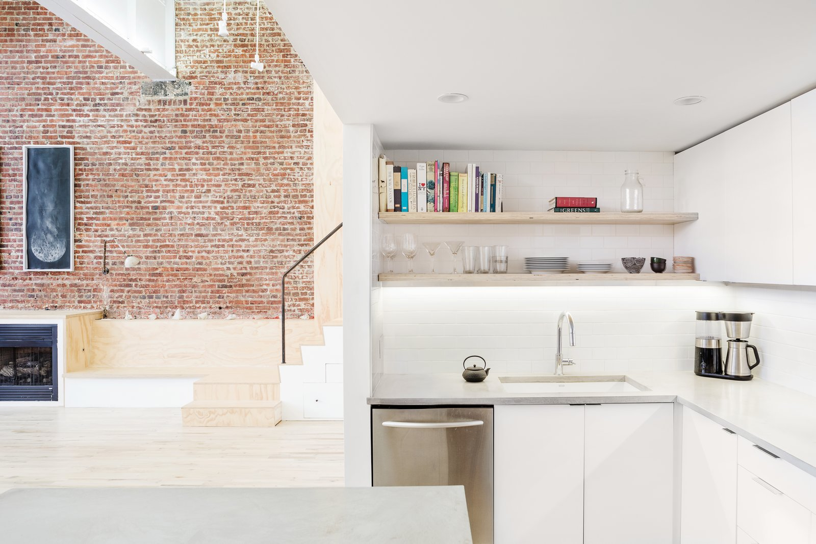 Kitchen, Light Hardwood, White, Concrete, Subway Tile, Undermount, Ceiling, and Dishwasher Kitchen looking back to stair and fireplace  Best Kitchen Subway Tile Concrete Photos from Kitchens