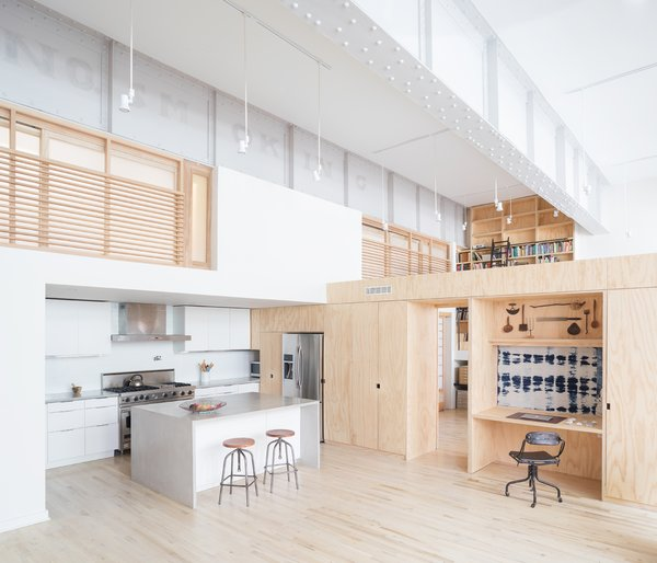 Living and kitchen space with loft bedrooms above