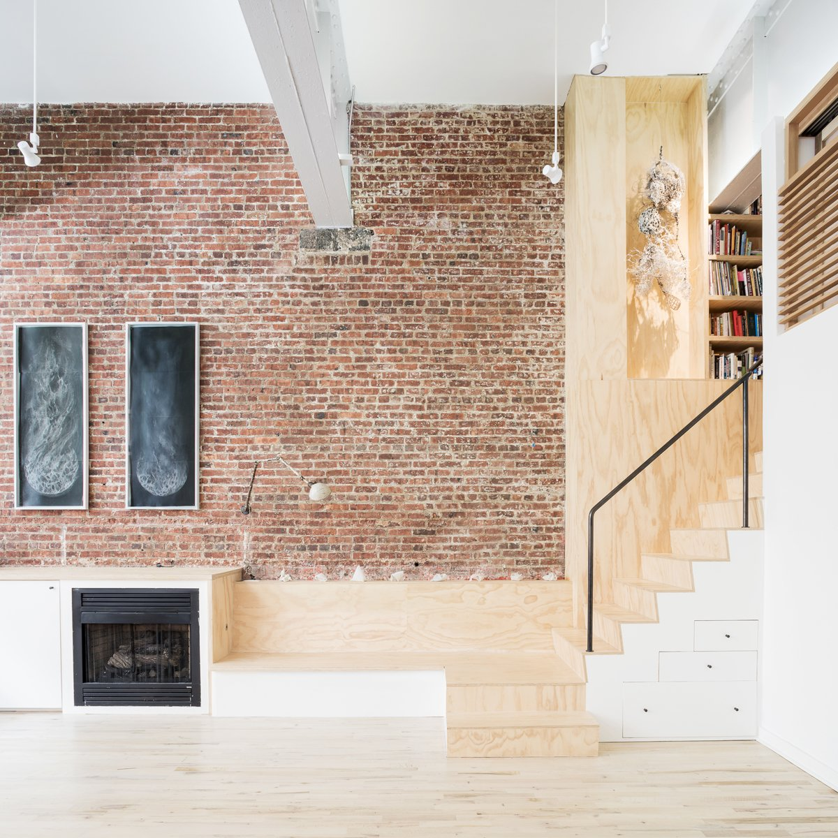 Living Room, Track Lighting, Bench, Accent Lighting, Light Hardwood Floor, and Standard Layout Fireplace Plywood stair and bench seat adjacent to fireplace  Wells Fargo Loft by Jeff Jordan Architects