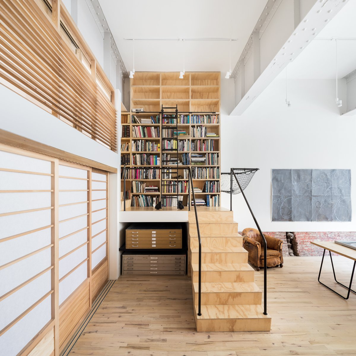 Office, Library Room Type, Craft Room Room Type, Study Room Type, Chair, Light Hardwood Floor, Bookcase, and Shelves Studio space and stair  Wells Fargo Loft by Jeff Jordan Architects