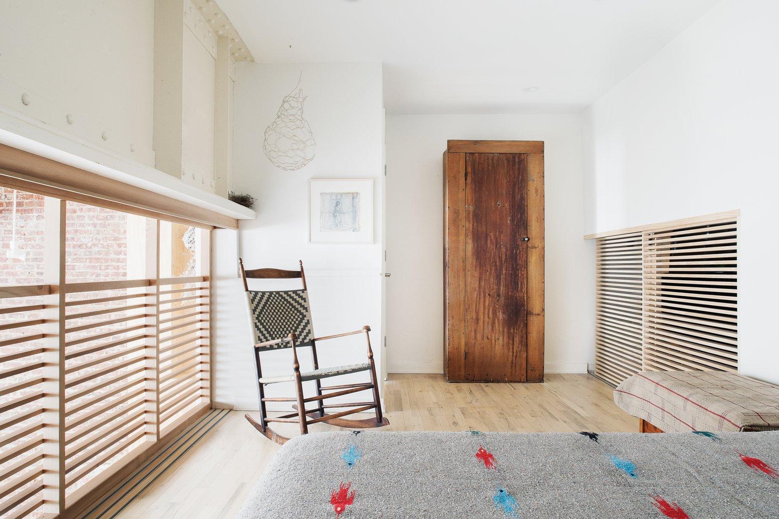 Bedroom, Wardrobe, Bed, Chair, Night Stands, Recessed Lighting, and Light Hardwood Floor Loft bedroom  Wells Fargo Loft by Jeff Jordan Architects