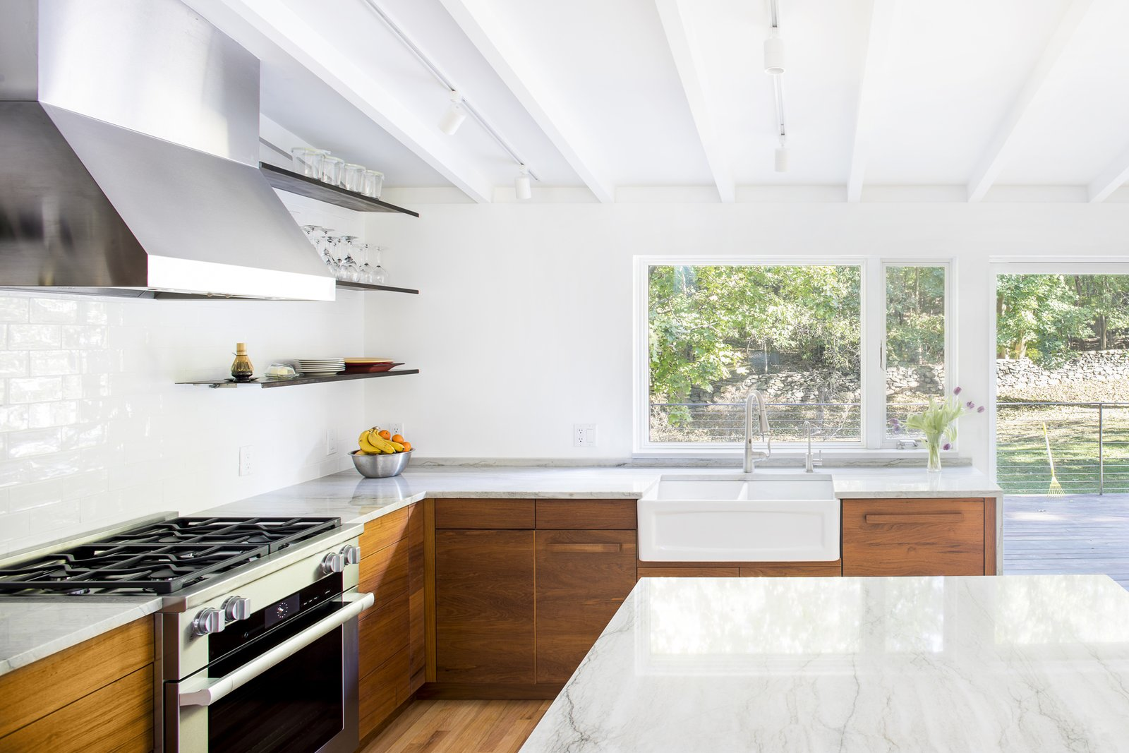 Kitchen, Range, Range Hood, Dishwasher, Marble, Wood, Medium Hardwood, Ceramic Tile, Track, Ceiling, and Undermount Kitchen looking to back yard  Best Kitchen Range Medium Hardwood Ceiling Track Wood Marble Photos from Deertrack Lane