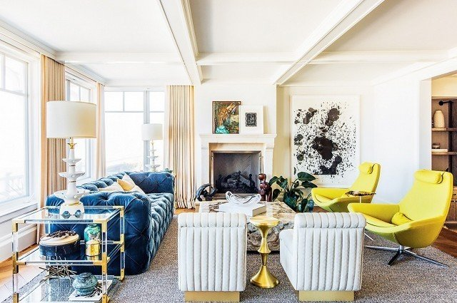 Say hello to a yellow that's anything but mellow. In this elegantly glam living room, the pair of lemon chairs packs a zesty punch. The chartreuse shade complements the rich upholstered textures, sleek stone, and metallic surfaces to create a light, fresh feeling. Design by Megan Tagliaferri #chartreuse #colorcrush #color #yellow #design #mydomaine  Our Latest Color Crush is Perfect for Summer