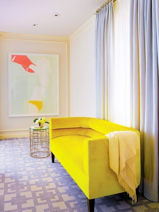 This chartreuse settée is just golden enough to add warmth and sunshine-y color to this bedroom space.  #chartreuse #colorcrush #color #yellow #design #mydomaine  Photo by Matthew Millman  Design by Palmer Weiss  Our Latest Color Crush is Perfect for Summer