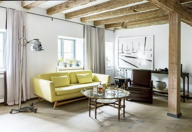 A lemon-lime sofa adds an unexpected slice of optimism to this Scandinavian home design filled with rustic wood and vintage metal.  Photo by Pernille Kaalund for Bo Bedre  #chartreuse #colorcrush #color #yellow #design #mydomaine  Our Latest Color Crush is Perfect for Summer