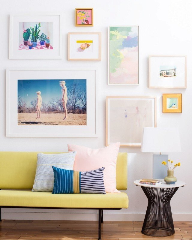 Perhaps chartreuse feels most at home surrounded by feminine colors. Pretty pastel pillows, paintings, and photography come together to create a gallery wall–meets-sofa moment that's all-around fresh-squeezed fun.  Photo by Jess Isaac Design by Emily Henderson  #chartreuse #colorcrush #color #yellow #design #mydomaine  Our Latest Color Crush is Perfect for Summer