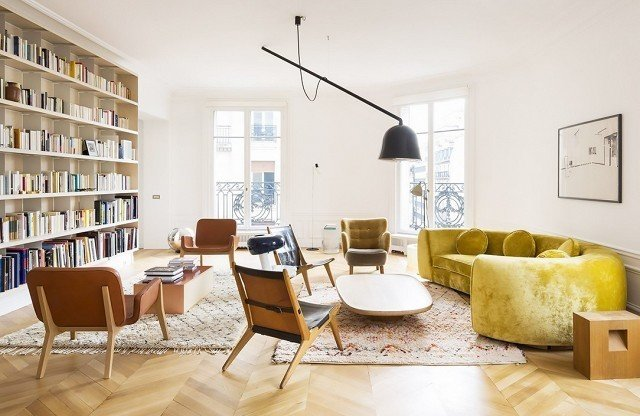 This curvy vintage velvet moment feels ripe and rich in a deeper chartreuse shade. Surrounded by midcentury furnishings, this darker yellow sofa projects sophisticated confidence, the kind that only improves with age.  Photo courtesy of Studio CMP  #chartreuse #colorcrush #color #yellow #design #mydomaine  Our Latest Color Crush is Perfect for Summer
