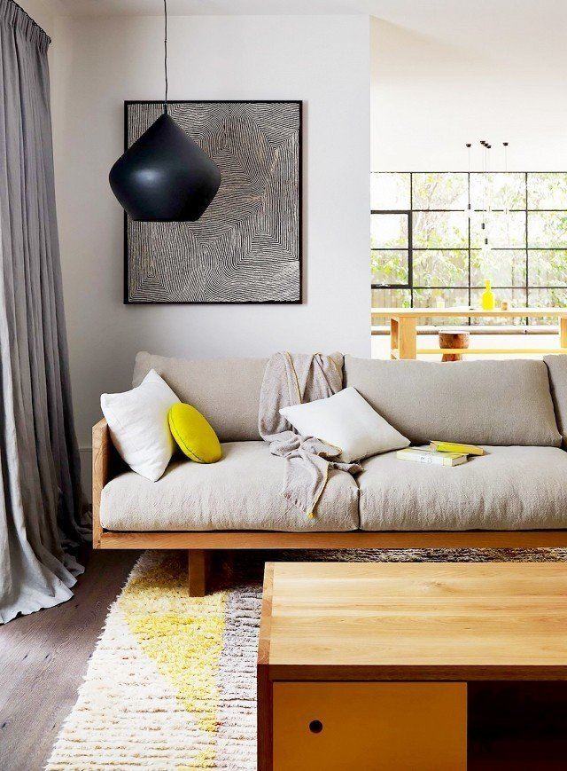Pillows and poufs make for perfect acidic accessories. In this home, chartreuse décor accents keep the eye dancing from surface to surface, creating color cohesion throughout. Each piece feels purposeful in connecting one room to the next.  Photo by Mark Tuckey  #chartreuse #colorcrush #color #yellow #design #mydomaine  Our Latest Color Crush is Perfect for Summer