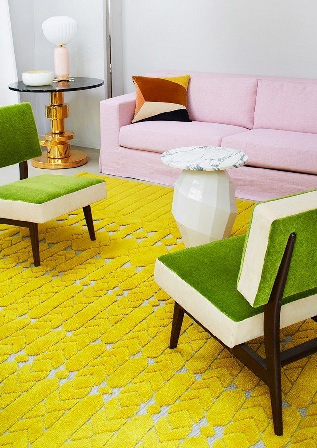 A textural retro rug in chartreuse contrasts off pretty pinks and grassy green shades in this living room vignette. The bold yellow color is ever so slightly sour, just enough to make you pucker up in the best way.  Photo courtesy of Manufacture Cogolin  #chartreuse #colorcrush #color #yellow #design #mydomaine  Rug Collection from Our Latest Color Crush is Perfect for Summer