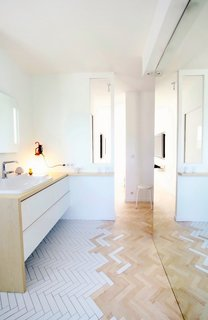 "This trend is made for small homes. ""I think this type of floor treatment is most appropriate in areas of transition, [like] entry areas, open baths, or even kitchens,"" says Zunino. Why? ""It's a creative way to delineate space without a hard line.""   Photo courtesy of Studio M  #design #interior #tiletransitioning #floor #bathroom  #mydomaine"