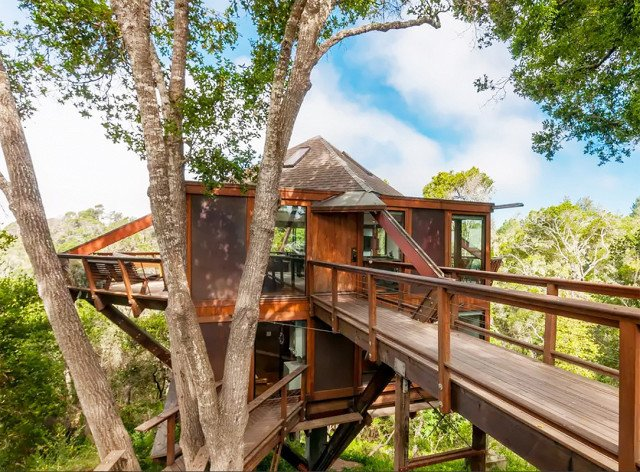 Located just outside of San Francisco in Santa Cruz, California, this heavenly home is perfect for a weekend getaway if you're in the bay area. Complete with ocean views and large glass windows that surround the entire structure, it can sleep up to six guests.  Photo 1 of 7 in 7 Breathtaking Tree Houses You Can Actually Rent on Airbnb