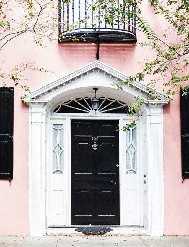 Knock, knock. Who's there? A fresh front door color combination. It doesn't get more classic that a jet-black front door, but in this case, the blush walls give the traditional shade a trendy new twist.  Photo 8 of 23 in What's the Best Color to Paint Your Front Door? Your Guide to Finding The One