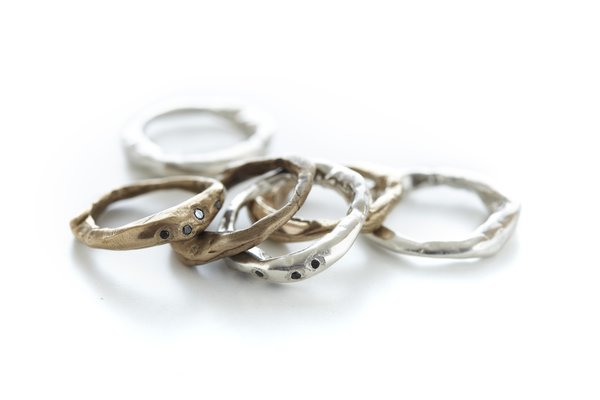 A mix and match set of bronze and silver rings.  Some even have black diamonds!  Favorites