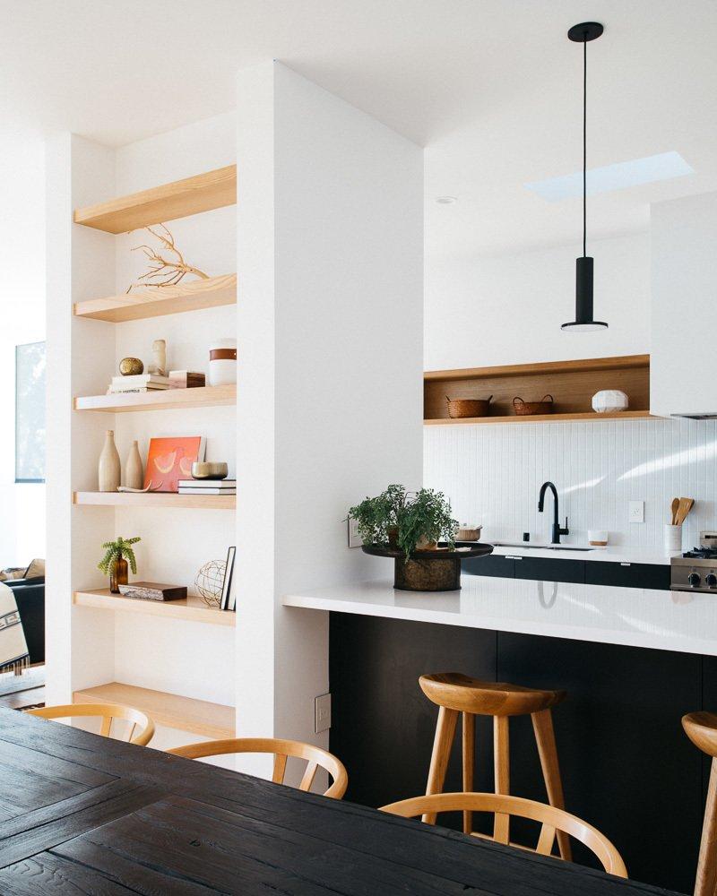 Kitchen, Engineered Quartz Counter, Wood Cabinet, Medium Hardwood Floor, Subway Tile Backsplashe, Pendant Lighting, Range, and Range Hood Kitchen  Tilt-Shift House by ANX / Aaron Neubert Architects