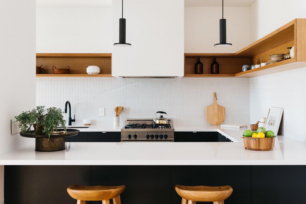 Kitchen, Engineered Quartz Counter, Wood Cabinet, Subway Tile Backsplashe, Pendant Lighting, Range, and Undermount Sink Kitchen  Tilt-Shift House by ANX / Aaron Neubert Architects