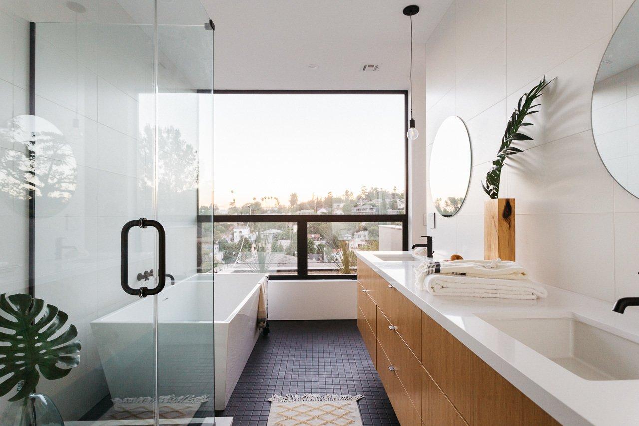 Bath Room, Porcelain Tile Floor, Engineered Quartz Counter, Undermount Sink, and Freestanding Tub Master Bathroom  Tilt-Shift House by ANX / Aaron Neubert Architects