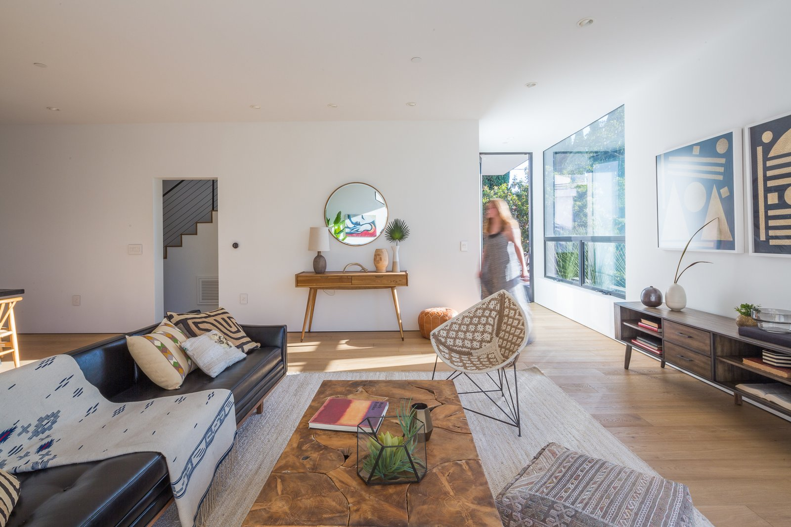 Living Room, Light Hardwood Floor, Sofa, Console Tables, Chair, Ottomans, and Recessed Lighting Living Room  Tilt-Shift House by ANX / Aaron Neubert Architects