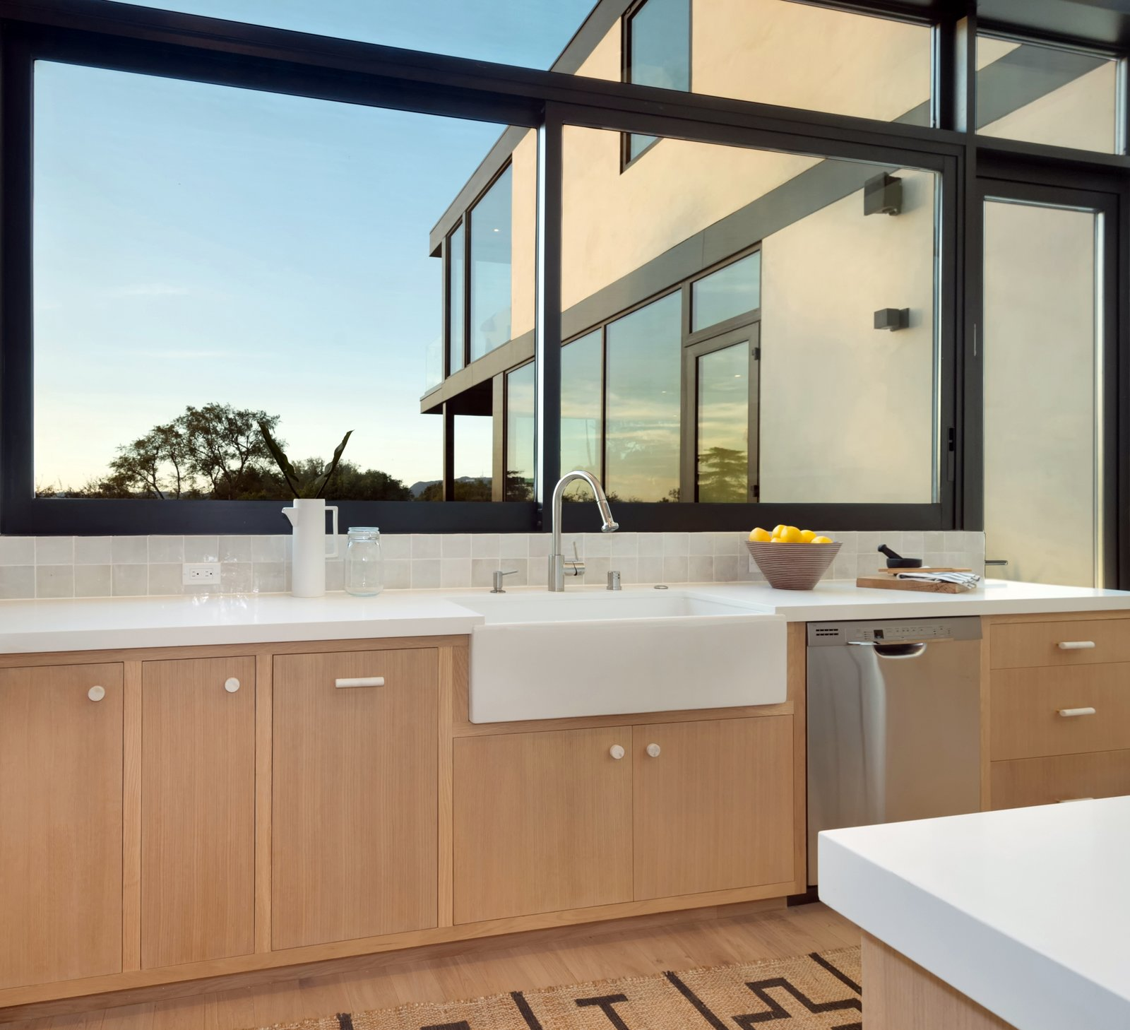 Kitchen, Ceramic Tile Backsplashe, Dishwasher, Engineered Quartz Counter, Medium Hardwood Floor, Vessel Sink, and Wood Cabinet Kitchen  SL House by ANX / Aaron Neubert Architects