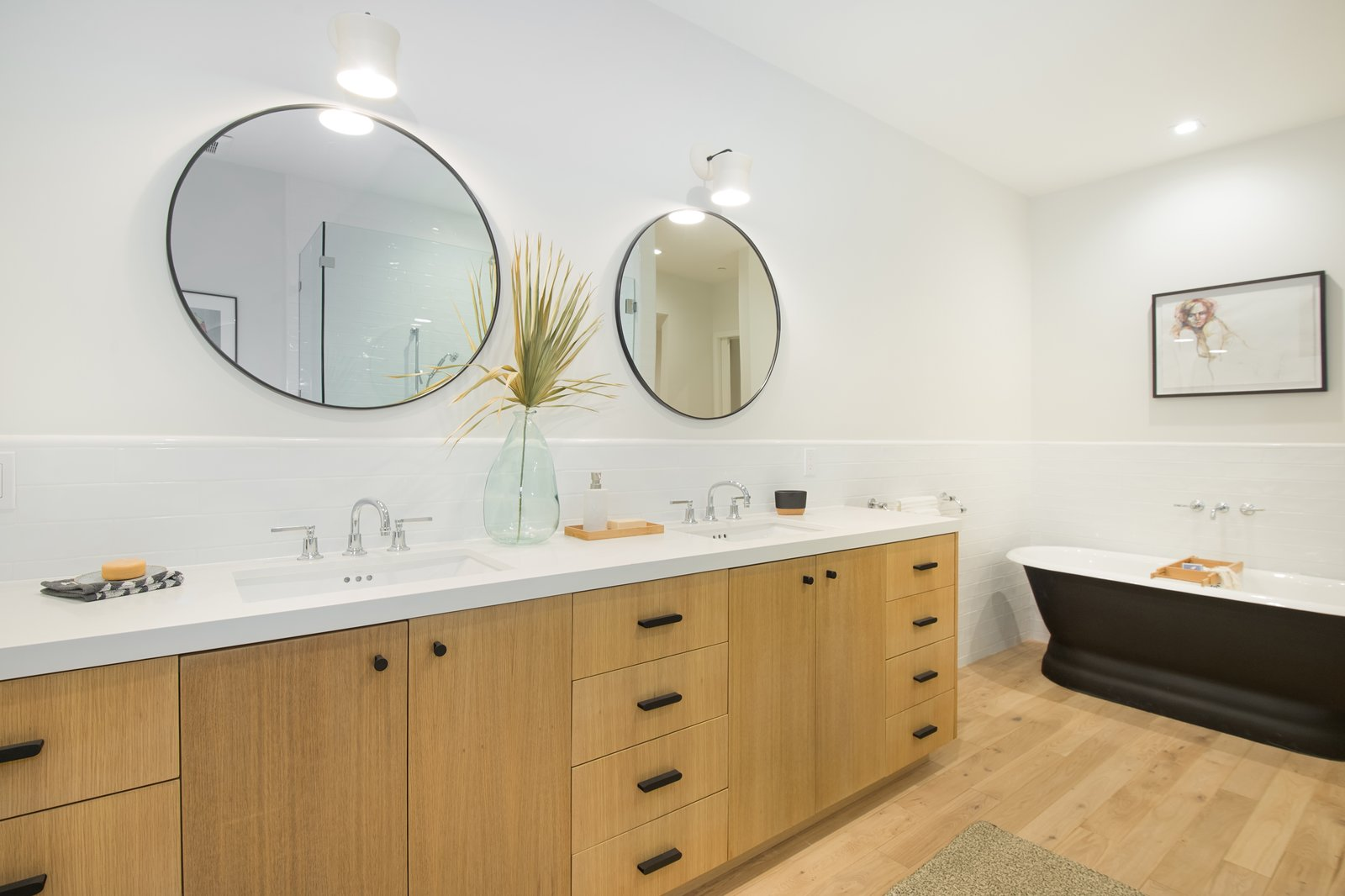 Bath Room, Subway Tile Wall, Ceiling Lighting, Medium Hardwood Floor, Recessed Lighting, Engineered Quartz Counter, Freestanding Tub, and Undermount Sink Master Bathroom  SL House by ANX / Aaron Neubert Architects