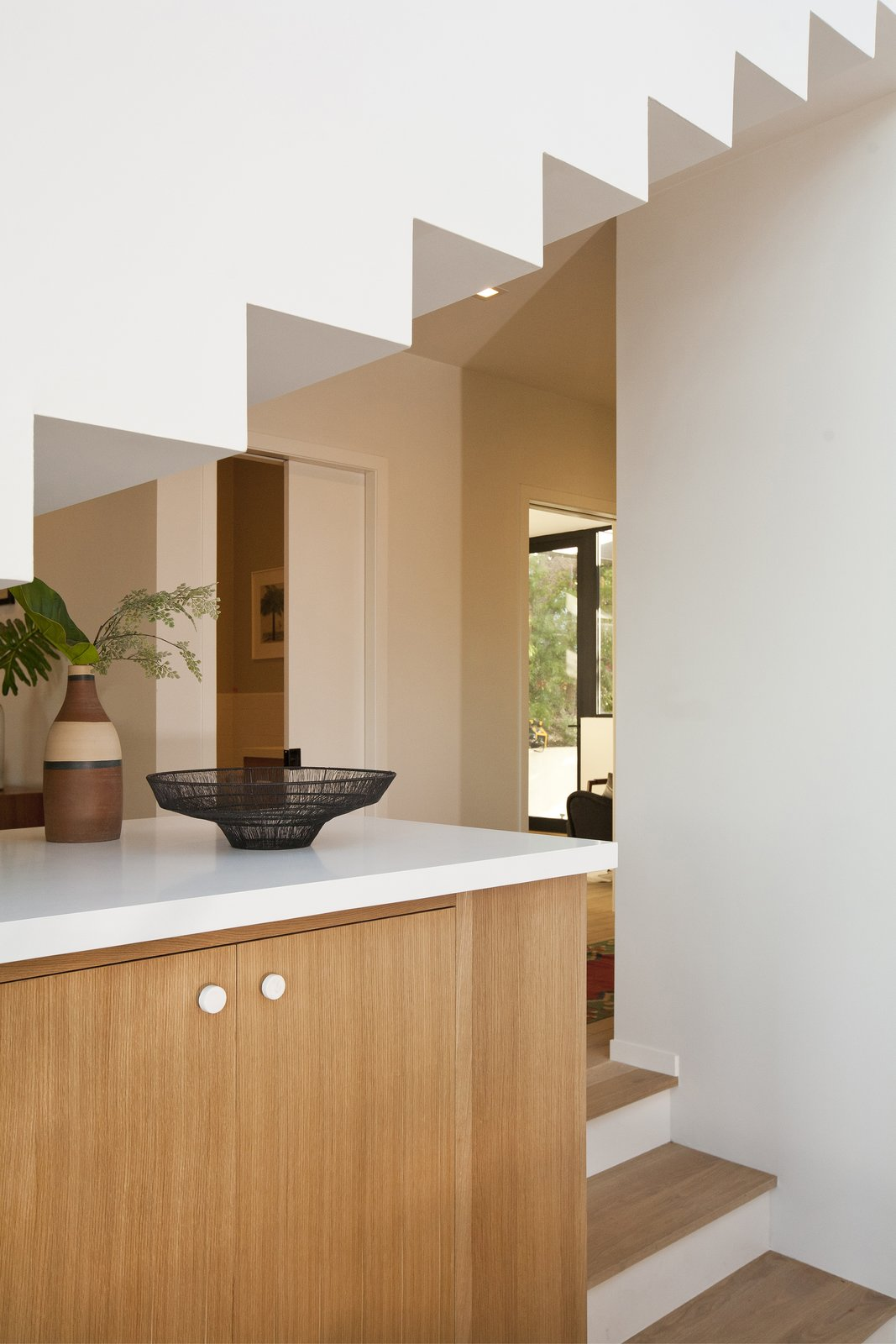 Kitchen, Wood Cabinet, Engineered Quartz Counter, Medium Hardwood Floor, Recessed Lighting, and Ceiling Lighting View to Entry  SL House by ANX / Aaron Neubert Architects