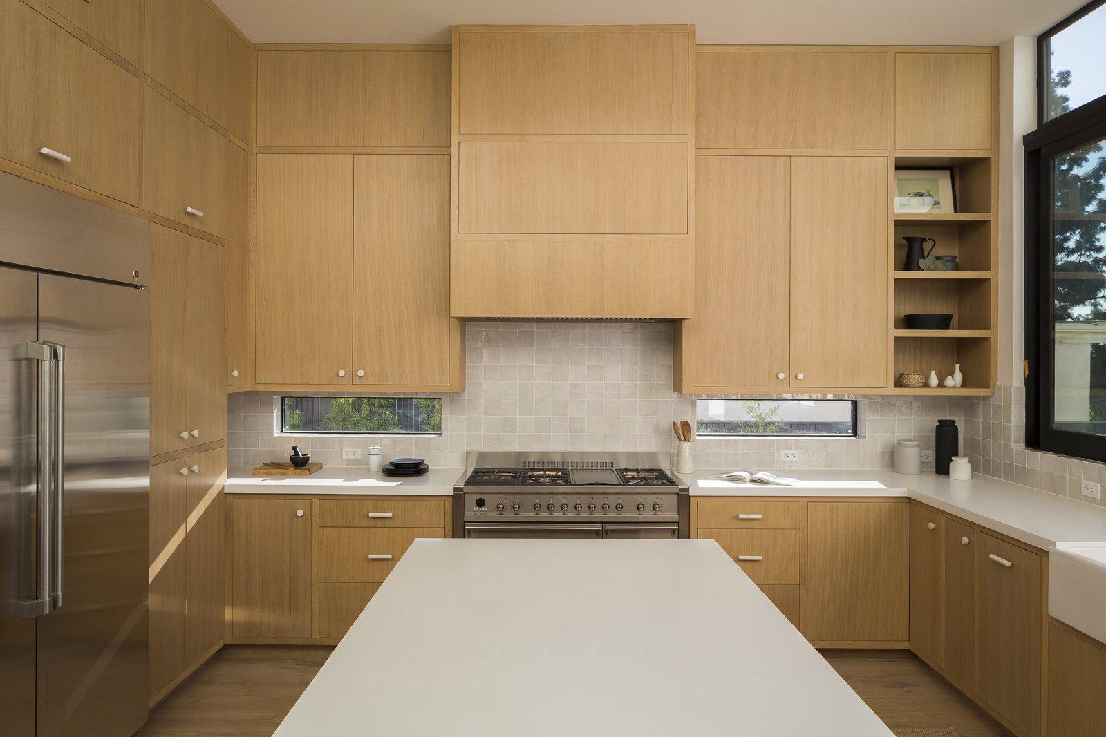 Kitchen, Vessel Sink, Range, Ceramic Tile Backsplashe, Wood Cabinet, Engineered Quartz Counter, Medium Hardwood Floor, and Refrigerator Kitchen  SL House by ANX / Aaron Neubert Architects