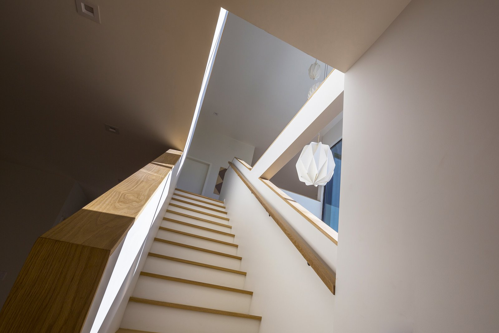 Staircase, Wood Railing, and Wood Tread Stair Volume  SL House by ANX / Aaron Neubert Architects