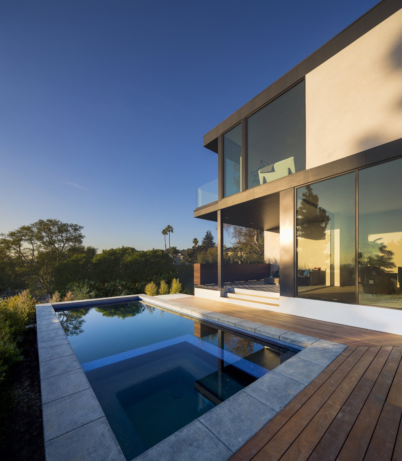 Exterior, Concrete Siding Material, Stucco Siding Material, House Building Type, Metal Roof Material, and Flat RoofLine Pool Deck  SL House by ANX / Aaron Neubert Architects