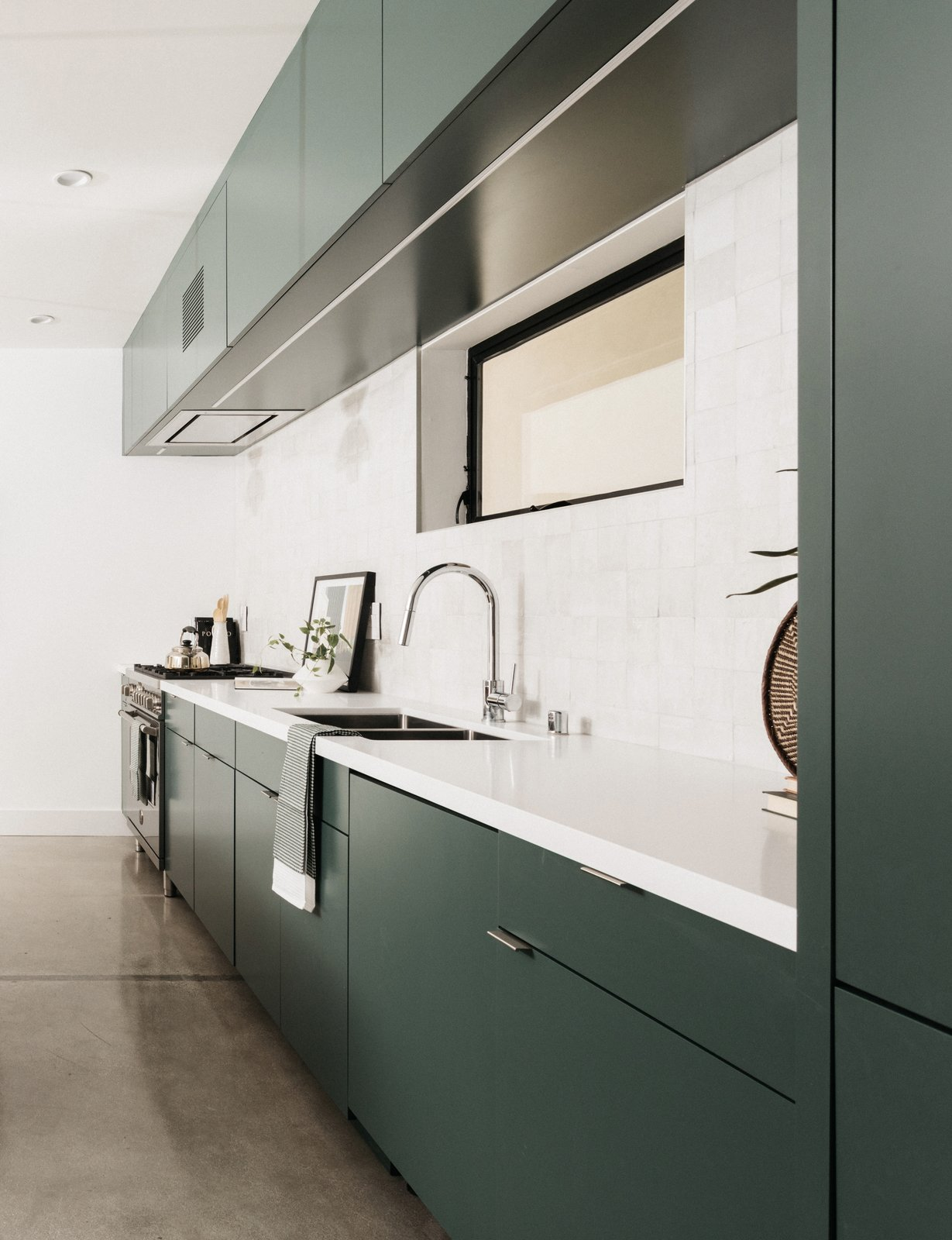 Kitchen, Ceramic Tile, Refrigerator, Cooktops, Concrete, Undermount, Engineered Quartz, Range, Colorful, and Recessed Kitchen  Best Kitchen Concrete Undermount Refrigerator Engineered Quartz Photos from Echo House