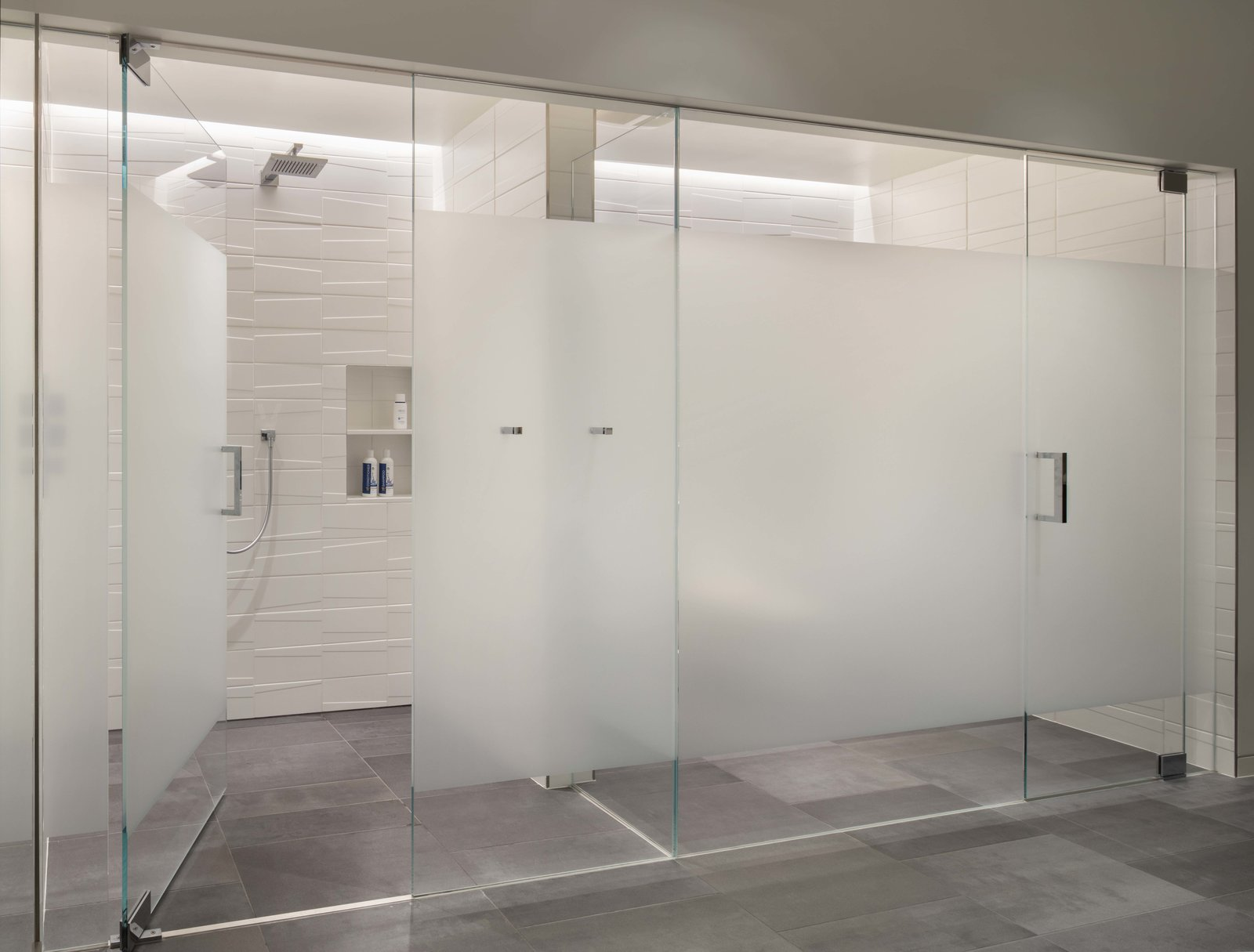 Bath Room, Porcelain Tile Floor, Recessed Lighting, Enclosed Shower, Ceramic Tile Wall, Ceiling Lighting, Accent Lighting, and One Piece Toilet Master Bath: Shower and Toilet rooms  the Duncan Residence