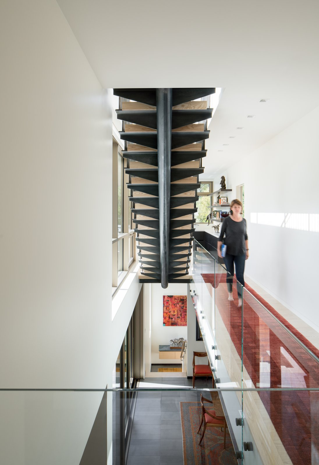 Staircase, Metal Tread, Wood Railing, Wood Tread, Glass Railing, and Metal Railing Stair to Roof  the Duncan Residence