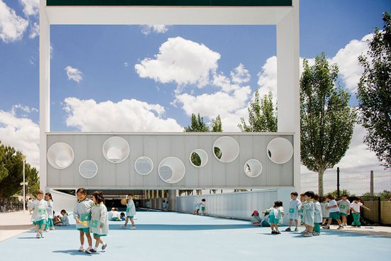 This airy dreamscape was imagined and designed by Spanish architects Eduardo Navadijos and Csaba Tarsoly in the city of Boadilla del Monte. Clean facades and wide pavilions make for a sunny yet protective structure. It's perfect for uninhibited fun on summer days.  Photo 2 of 11 in 10 Playgrounds With Modern Twists