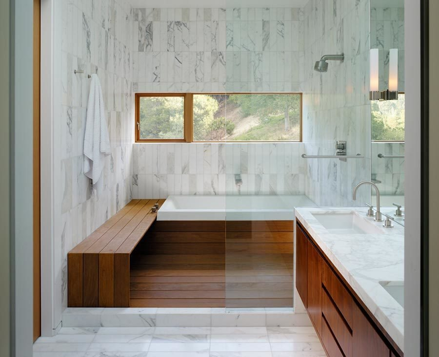 Bath Room, Enclosed Shower, Marble Wall, Marble Counter, Undermount Sink, and Drop In Tub Wood meets white marble in this well-lit bathroom by architect Craig Steely. Contrasting materials make for a warm and serene bathing atmosphere in this Berkeley, California home.  Photo 18 of 20 in 20 Bathrooms With Transformative Tiles