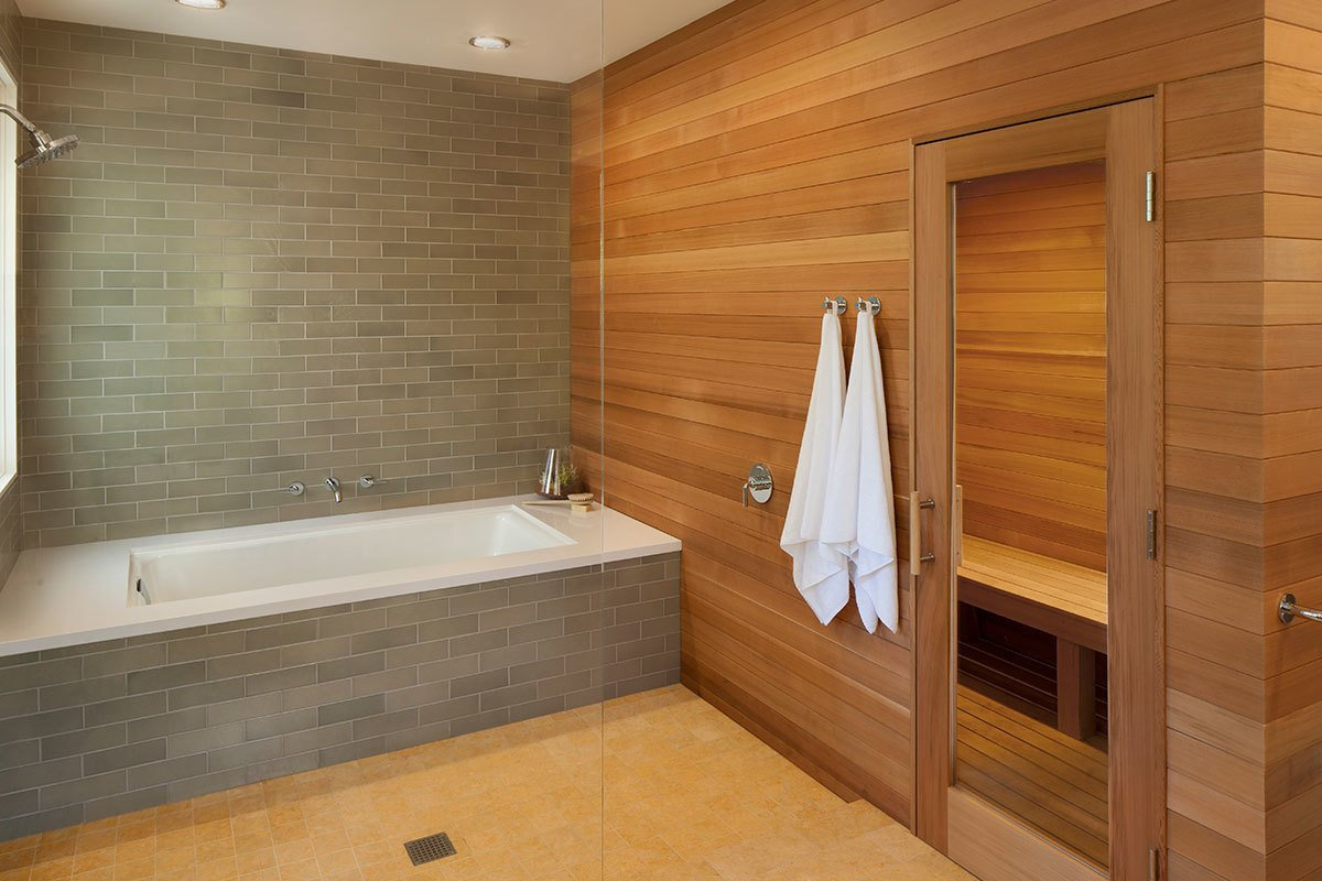 Natural wood warms the stone palette of this master bathroom designed by Mark Reilly Architecture.  Photo 7 of 10 in 10 Sterling Saunas in Modern Homes