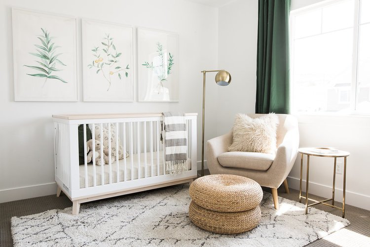 Kids Room, Bedroom Room Type, Bed, Chair, Carpet Floor, Toddler Age, and Neutral Gender The nursery of the Ironhorse Resident by Akin Design Studio provides clean earth tones and various textures. The nursery ties in the hushed palette from the rest of the home.  The aesthetic is soft, but mature and establishes a modern style a child can never easily outgrow.  Photo 9 of 16 in 15 Modern and Creative Spaces for Kids