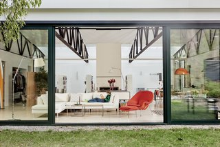 The floor-to-ceiling sliding doors open the home directly to the adjacent courtyard, while also providing excellent natural ventilation throughout.