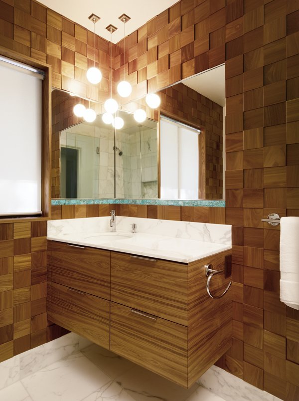 This nature-inspired bathroom  layers wood tones and sculptural texture.  Ridge Road