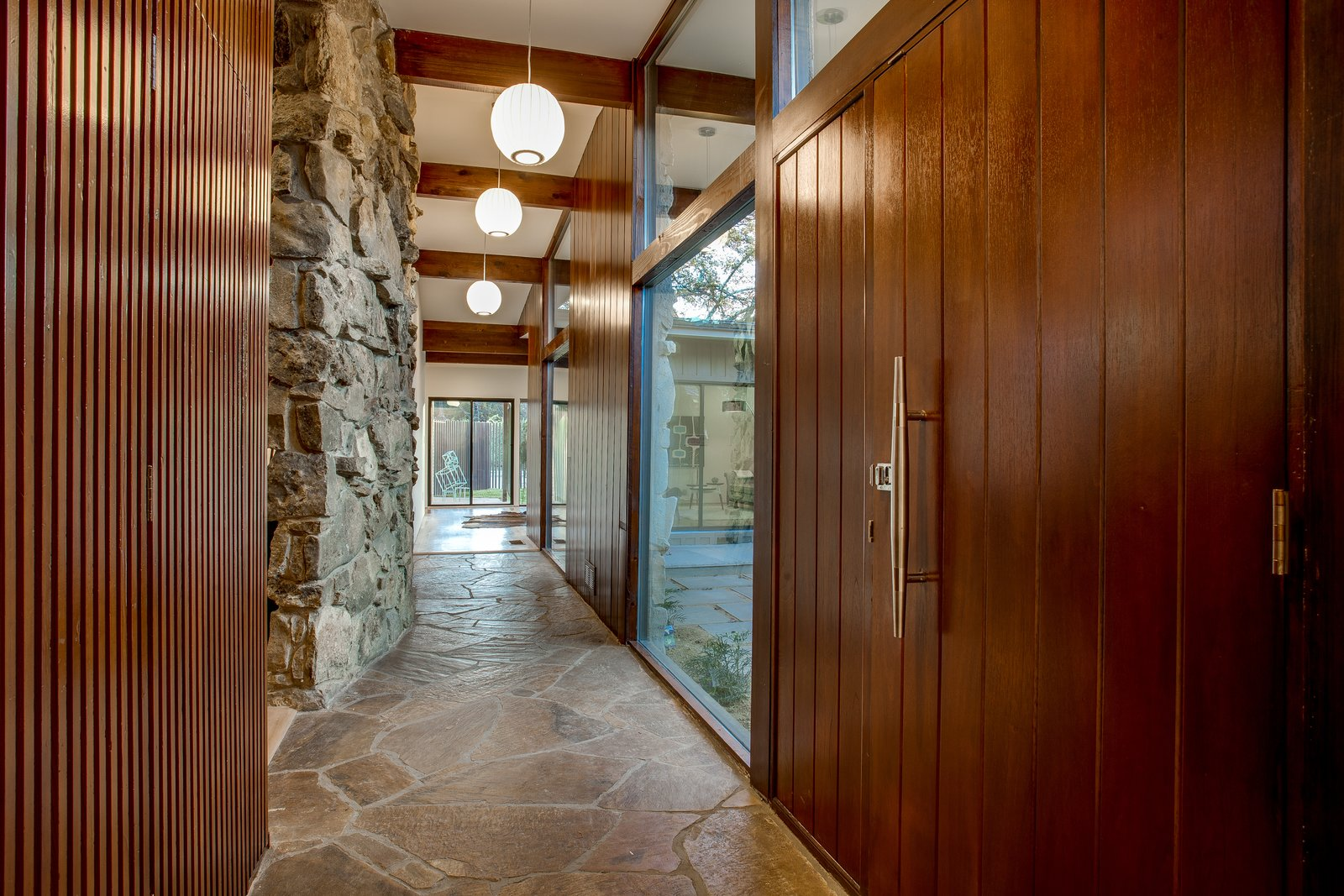 Hallway Entry hall after  1963 Post and Beam Mid Century Modern by Tavis Westbrook