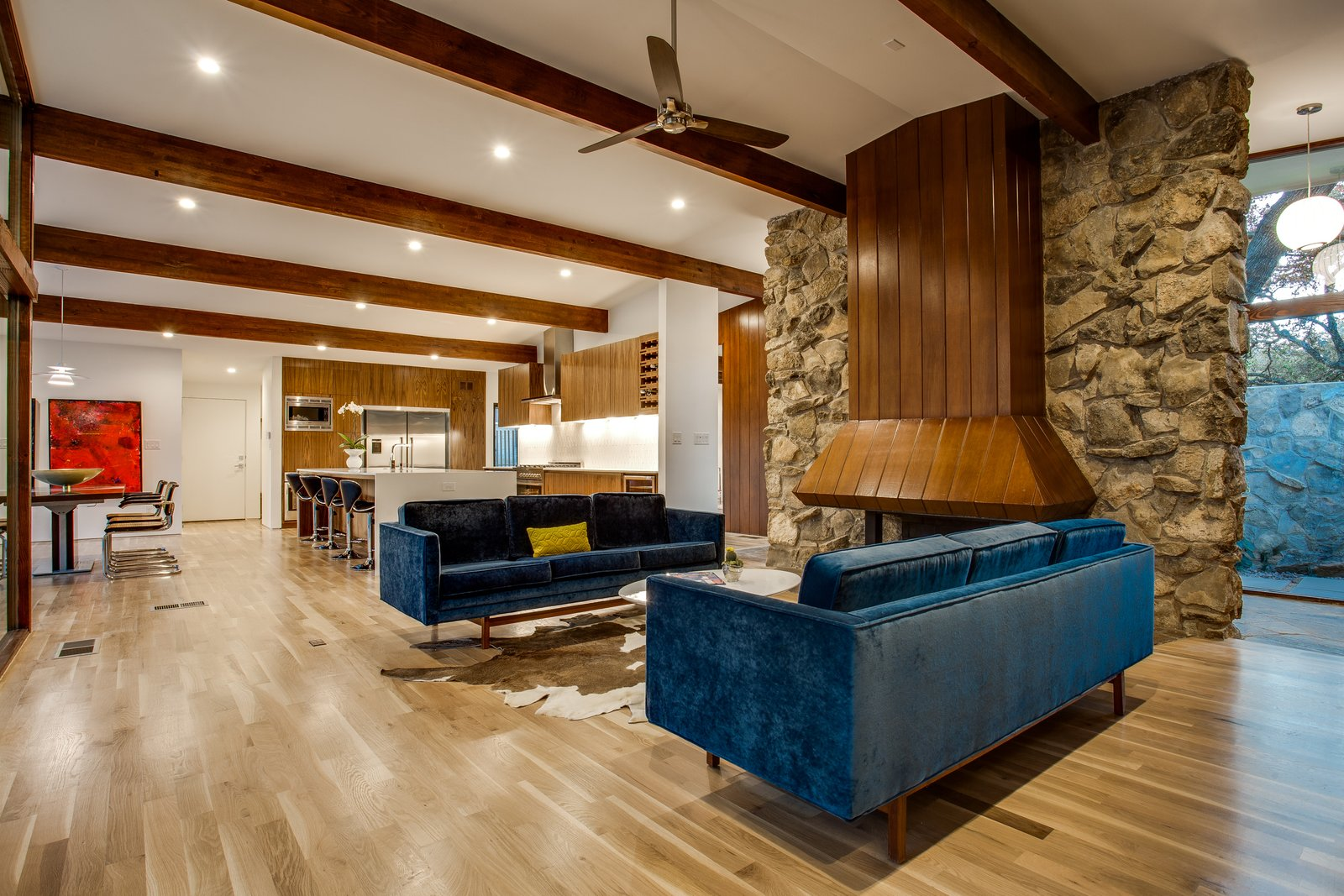 Living Room, Sofa, Recessed Lighting, Ceiling Lighting, Light Hardwood Floor, Gas Burning Fireplace, and Standard Layout Fireplace Family and fireplace after  1963 Post and Beam Mid Century Modern by Tavis Westbrook