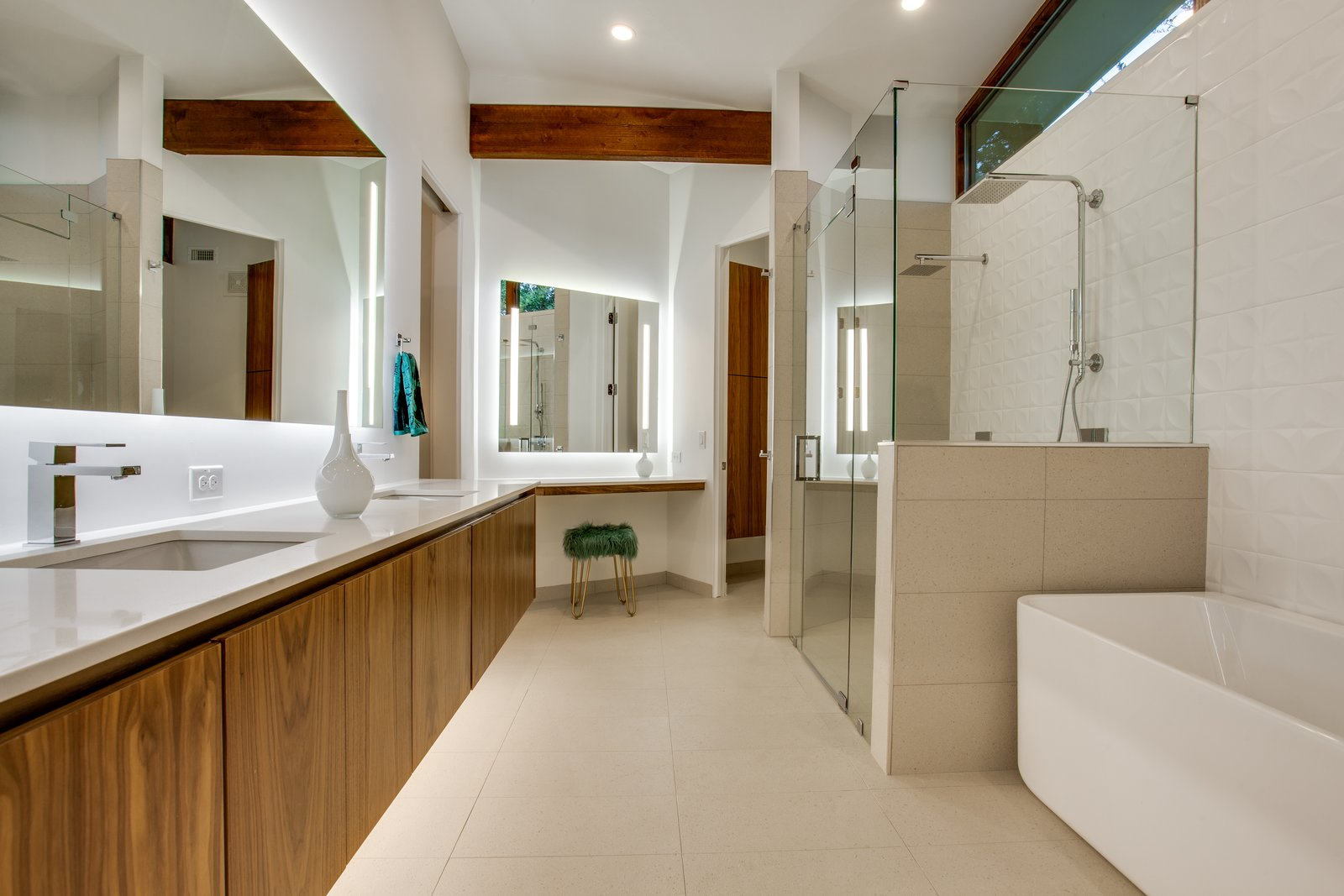 Bath Room, Engineered Quartz Counter, Freestanding Tub, Enclosed Shower, Ceiling Lighting, Recessed Lighting, Accent Lighting, Ceramic Tile Wall, Ceramic Tile Floor, Wall Lighting, and Two Piece Toilet Master bath after  1963 Post and Beam Mid Century Modern by Tavis Westbrook