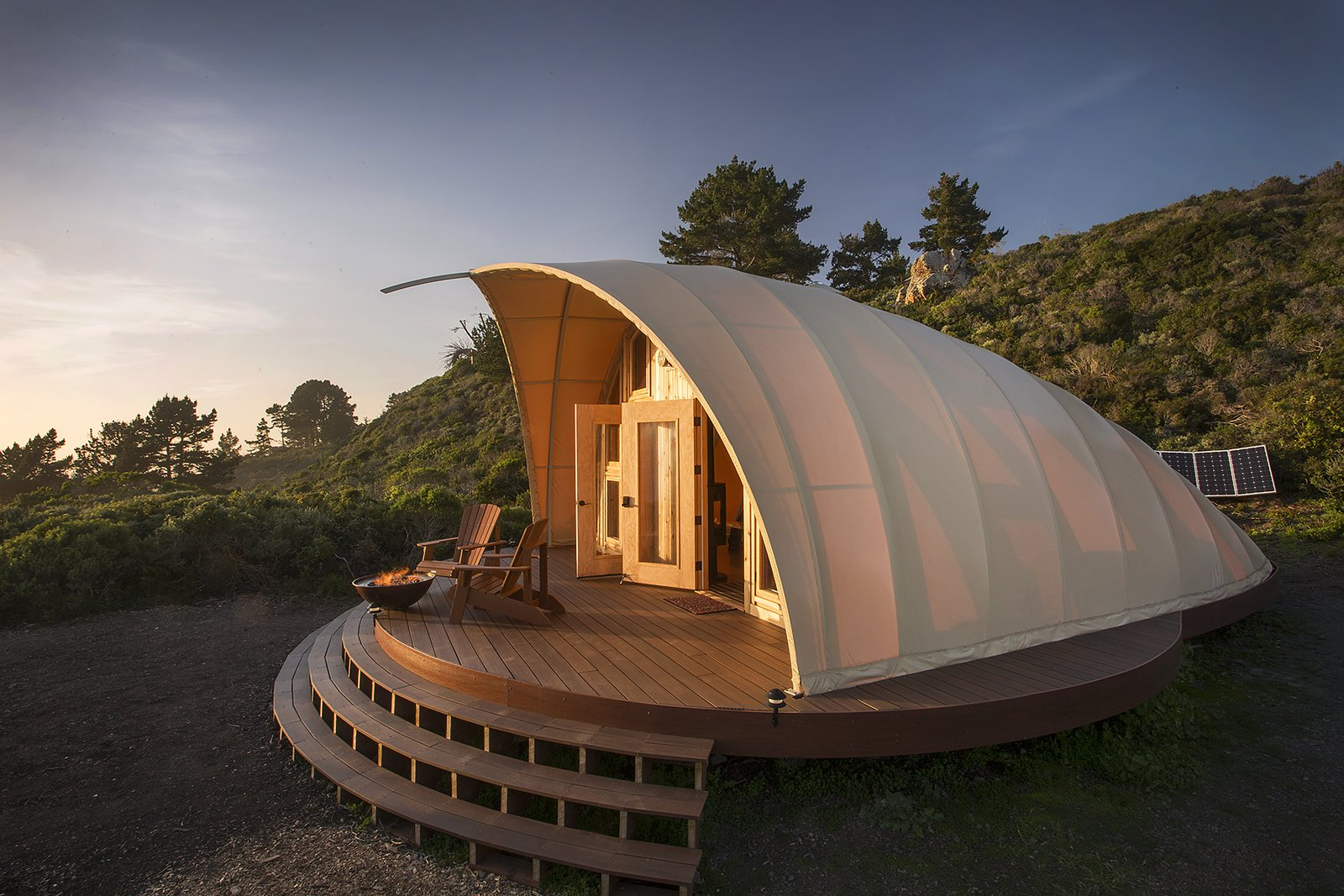 The Autonomous Tent - It's kind of like a yurt, only the high tech manufacturing process ensures absolute precision providing simple installation and a tight seal between fabric and frame that cannot be accomplished with a yurt, making the structure look and feel more permanent.   Cabins & Hideouts