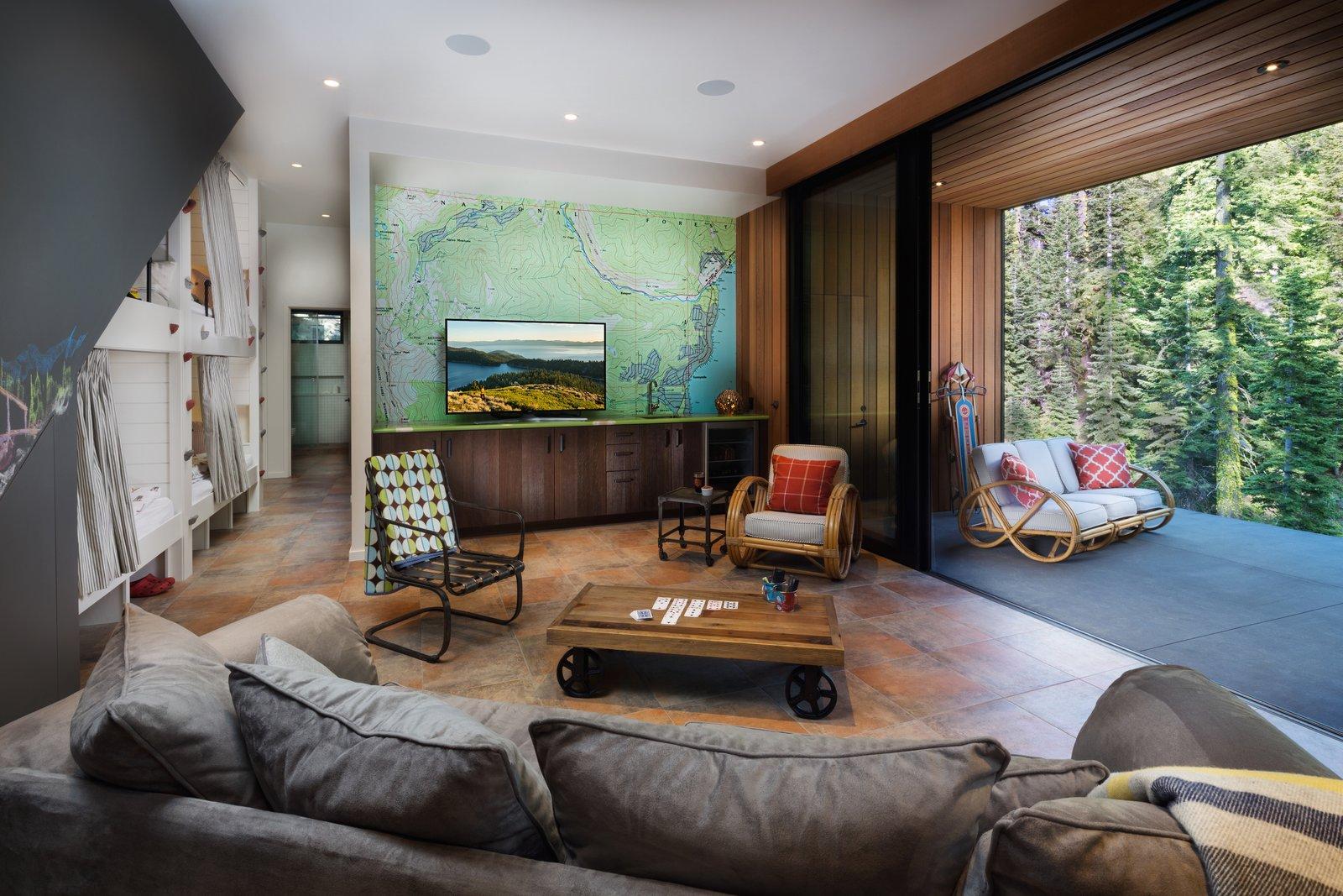 Den with indoor/outdoor patio and Tahoe map  New Tahoe