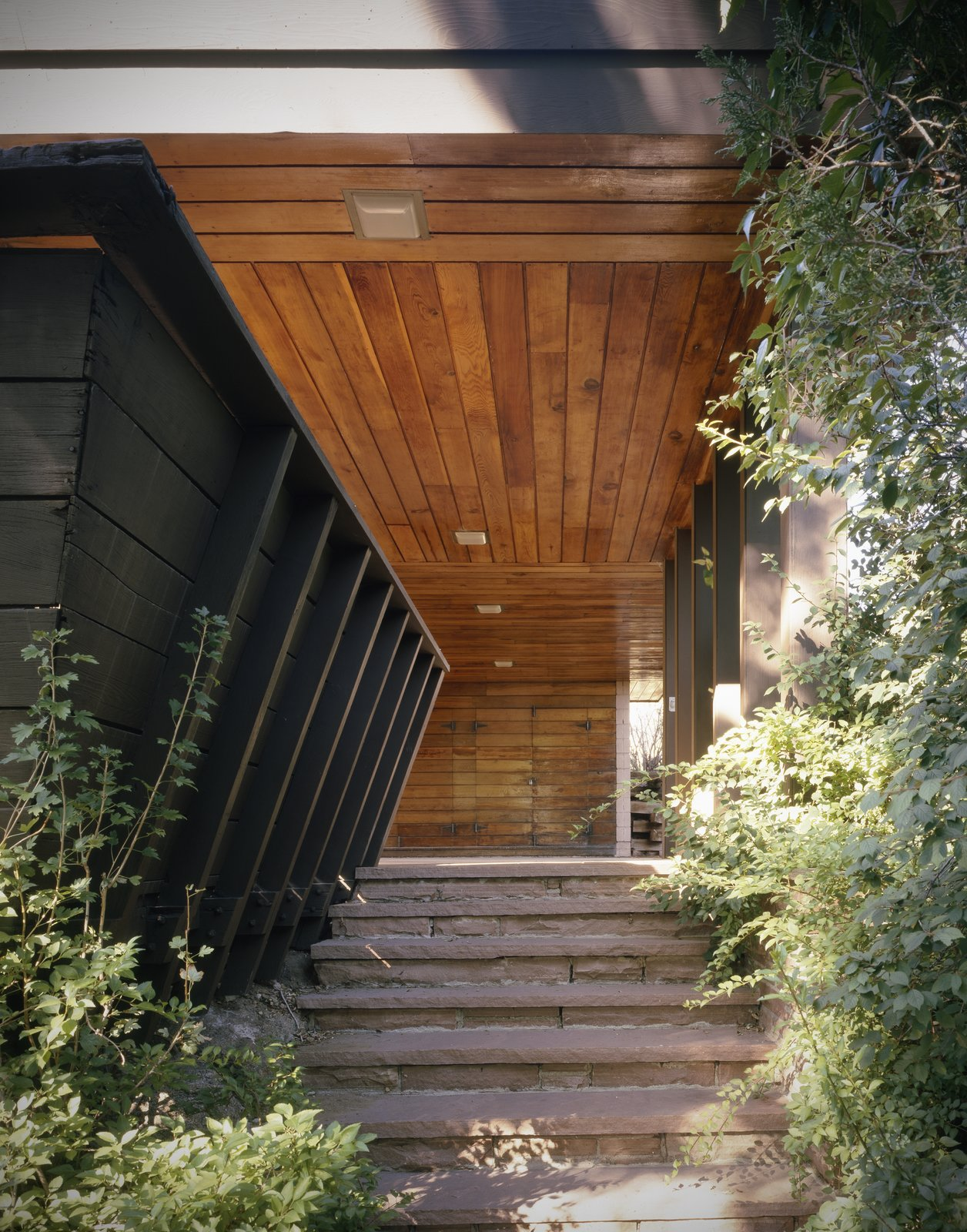 This is the first of two homes designed for the Vradenburg family by Ingraham and Ingraham, Architects. The overhang here serves as both coverage for the entrance and carport. Like Frank Lloyd Wright's designs, Ingraham tucked away her unusual entrances from obvious view.  Photo 2 of 5 in An Architect in Her Own Wright