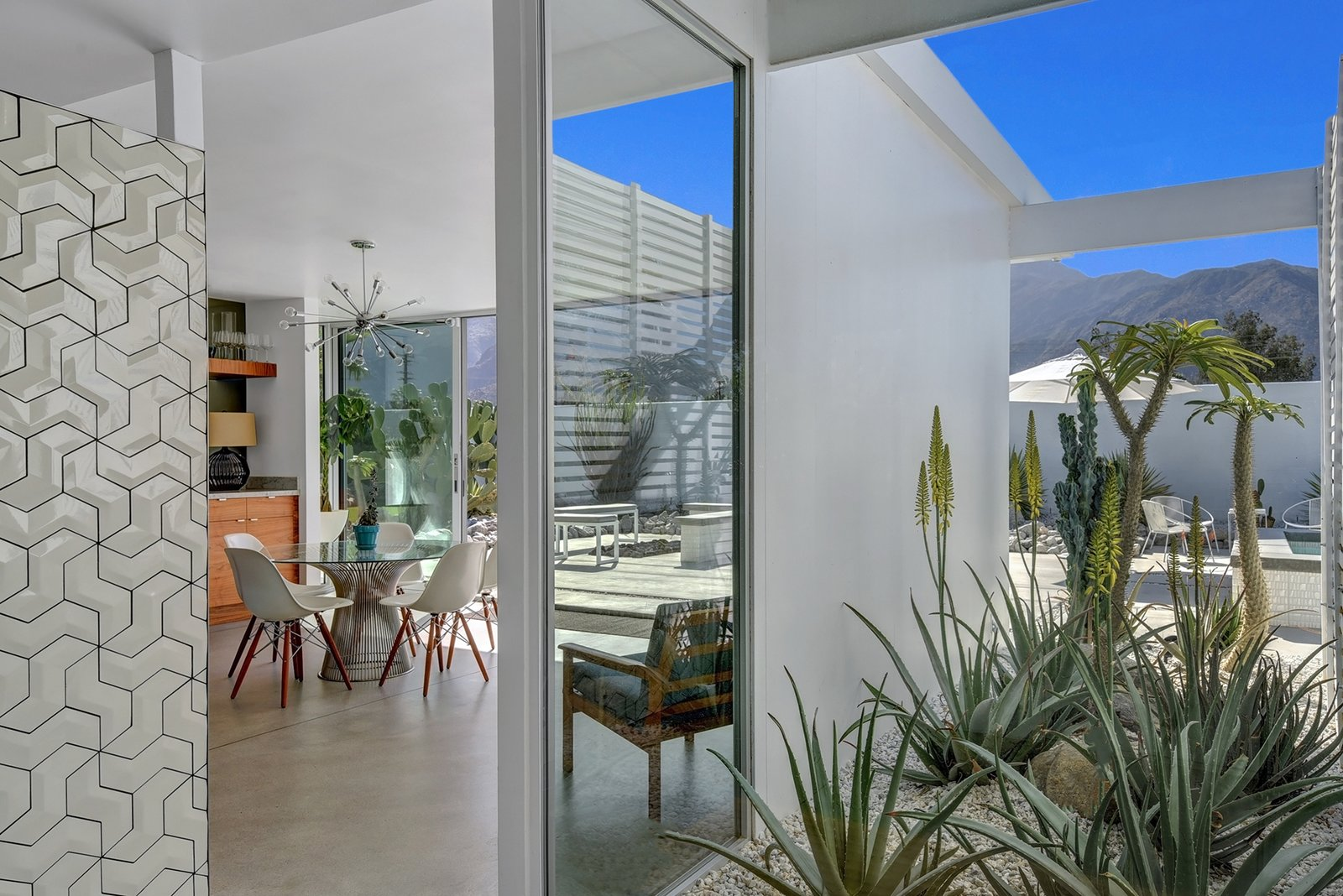 Outdoor, Garden, Hardscapes, Stone, and Side Yard Just seven Wexler Steel Homes were built, as the rising costs of steel prohibited the full neighborhood development.  Best Outdoor Stone Garden Photos from Donald Wexler Himself Helped Renovate This Palm Springs Prefab Rental