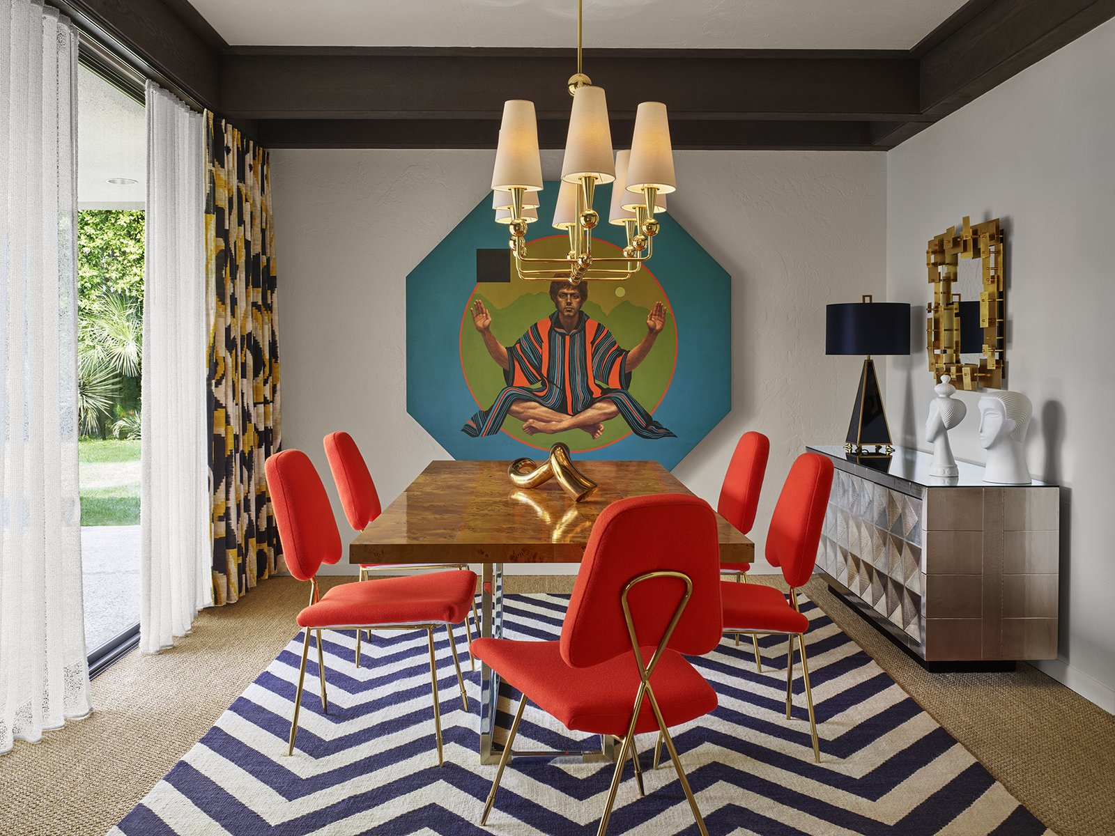 "Dining Room, Storage, Chair, Table, Rug Floor, Pendant Lighting, and Table Lighting ""The vibe is cheeky hedonistic luxury,"" designer Jonathan Adler said to describe the Parker Palm Springs.  Photo 6 of 7 in Jonathan Adler Reveals His Redesign of the Parker Palm Springs"