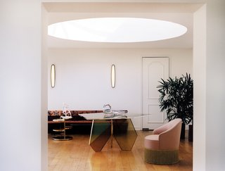 Daylight filters in not only through ceiling-to-floor glass in this mid-century modern gem, but also through this significant light well at Casa Perfect.