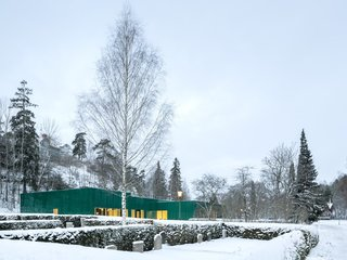 Wingårdhs developed a low-impact solution that would complement the garden surroundings of this administration center at Sundbyberg Cemetery outside of Stockholm.