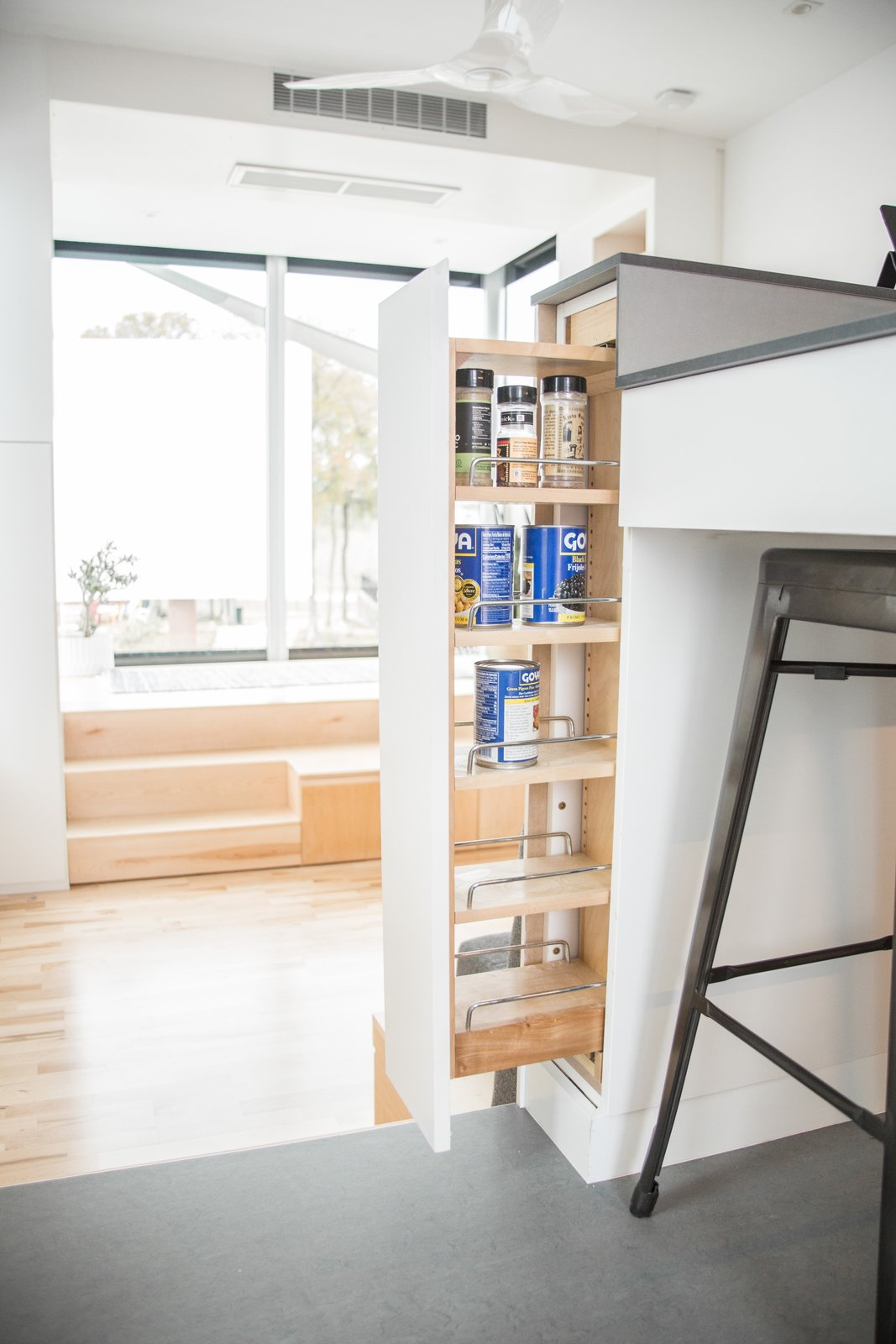 Living Room, Storage, and Light Hardwood Floor Every nook and cranny was utilized to save smartly save space and conceal clutter.  Photo 4 of 9 in Can These Tiny, Modular Smart Homes Relieve the Demand For Affordable Housing?