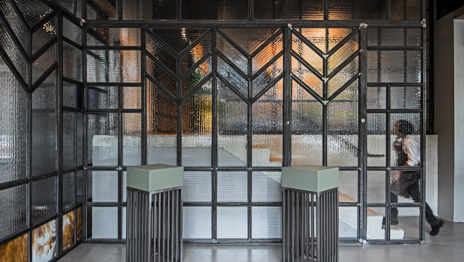 """Doors, Interior, Sliding Door Type, and Metal """"Looking at the stained glass, I started there and scaled up,"""" says designer Kevin Heisler. """"I wanted to create great scale with no seam, so it doesn't feel like a door.""""  Photo 3 of 12 in Run, Don't Walk to This Frank Lloyd Wright-Inspired Bar in Chicago"""