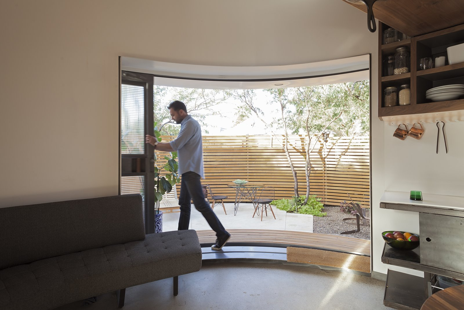 """Doors, Sliding Door Type, and Exterior """"The sliding door, when you open it, opens a large chunk of living space that more than doubles the perceived space,"""" says Christoph Kaiser. """"The big aperture moves and connects you with the lush, desert garden.""""  Best Photos from An Old Grain Silo Makes an Enchanting Tiny Home in Phoenix"""